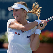 August 16, 2014, New Haven, CT:<br /> Ekaterina Makarova hits a backhand during a match against Roberta Vinci on day three of the 2014 Connecticut Open at the Yale University Tennis Center in New Haven, Connecticut Sunday, August 17, 2014.<br /> (Photo by Billie Weiss/Connecticut Open)
