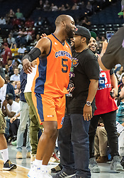 July 6, 2018 - Oakland, CA, U.S. - OAKLAND, CA - JULY 06:Baron Davis (5) co-captain of 3's Company gets congratulations from the court side fans following the win of game 1 in week three of the BIG3 3-on-3 basketball league on Friday, July 6, 2018 at the Oracle Arena in Oakland, CA  (Photo by Douglas Stringer/Icon Sportswire) (Credit Image: © Douglas Stringer/Icon SMI via ZUMA Press)