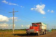 Truck and car near Rodas in Cienfuegos, Cuba.