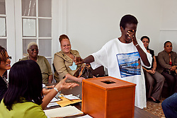 Ada Hodge prays that she'll get the number she asked for.   The ICM Candidate for the Territorial Committee District/Board of Elections St. Thomas/St. John pulled #4.  Casting of Lots for the Primary Election of September 8, 2012.  Election Sytem of the Virgin Islands.  21 August 2012.  © Aisha-Zakiya Boyd