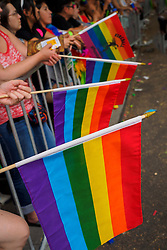 United States, Washington, Seattle Gay Pride Parade, June 28th, 2015. Spectators with rainbow flags.