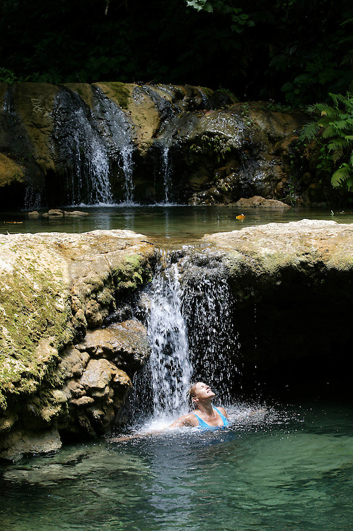 A visitor enjoying the cool waters of the Mele Cascade waterfalls outside Port Vila on the island of Efate, Vanuatu, February 04, 2006. Credit:SNPA / Rob Tucker