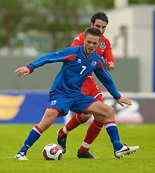 REYKJAVIK, ICELAND - Wednesday, May 28, 2008: Wales' Craig Morgan and Iceland's Palmi Rafn Palmason during the international friendly match at the Laugardalsvollur Stadium. (Photo by David Rawcliffe/Propaganda)