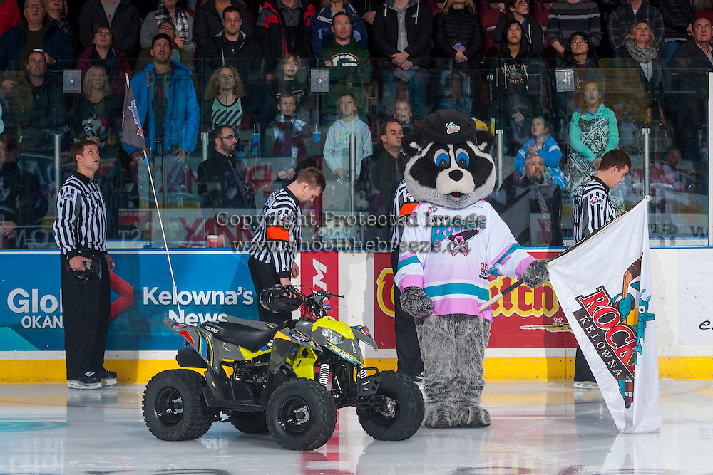 KELOWNA, CANADA - DECEMBER 30: Rocky Racoon, the mascot of the Kelowna Rockets stands on the ice with ice officials on December 30, 2016 at Prospera Place in Kelowna, British Columbia, Canada.  (Photo by Marissa Baecker/Shoot the Breeze)  *** Local Caption ***