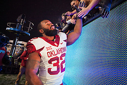 Nov 19, 2016; Morgantown, WV, USA; Oklahoma Sooners running back Samaje Perine (32) celebrates with fans after beating the West Virginia Mountaineers at Milan Puskar Stadium. Mandatory Credit: Ben Queen-USA TODAY Sports