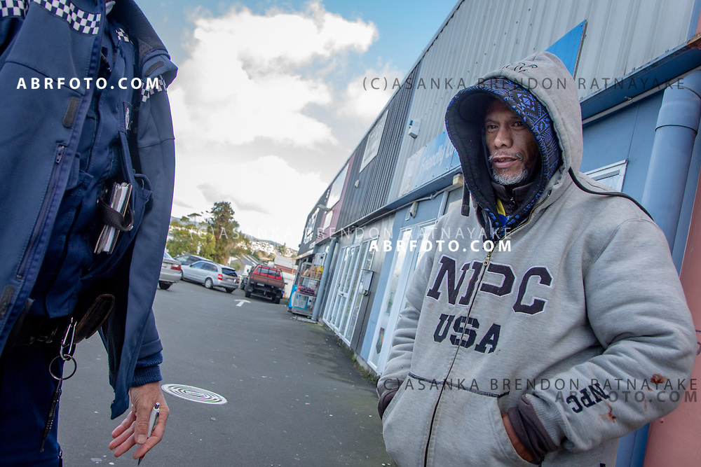 Joseph Takairangi outside shops in Henderson as he is issued a trespass notice from the Henderson community constable on the 7th of June 2018. Joseph Takairangi has been warned previously about loitering around the Henderson shops. The issuing officer has worked with a number of the homeless in the area and responds often to complaints from local shop owners. Asanka Brendon Ratnayake for The New York Times.