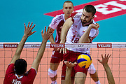 Marcin Mozdzonek from Poland in action during the 2013 CEV VELUX Volleyball European Championship match between Poland and Turkey at Ergo Arena in Gdansk on September 20, 2013.<br /> <br /> Poland, Gdansk, September 20, 2013<br /> <br /> Picture also available in RAW (NEF) or TIFF format on special request.<br /> <br /> For editorial use only. Any commercial or promotional use requires permission.<br /> <br /> Mandatory credit:<br /> Photo by &copy; Adam Nurkiewicz / Mediasport