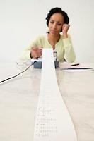 Woman Reading Adding Machine Tape