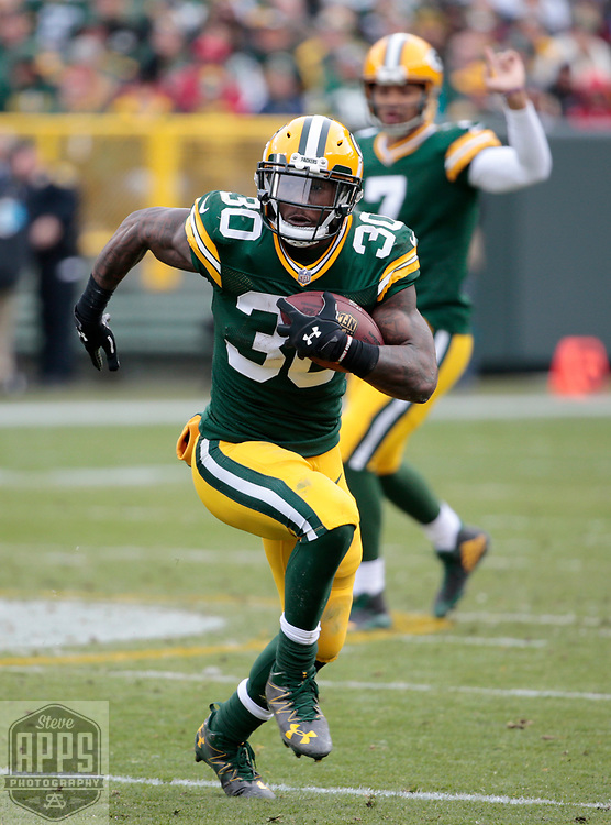 Green Bay Packers running back Jamaal Williams (30) on a 25-yard run in the 2nd quarter. Williams was pushed out of bounds by Tampa Bay Buccaneers cornerback Ryan Smith (29). <br /> The Green Bay Packers hosted the Tampa Bay Buccaneers at Lambeau Field in Green Bay,  Sunday, Dec. 3, 2017.  STEVE APPS FOR THE STATE JOURNAL.
