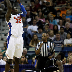 Mar 26, 2011; New Orleans, LA; Florida Gators center Vernon Macklin (32) shoots and draws a foul from Butler Bulldogs forward Khyle Marshall (23) during the first half of the semifinals of the southeast regional of the 2011 NCAA men's basketball tournament at New Orleans Arena.   Mandatory Credit: Derick E. Hingle