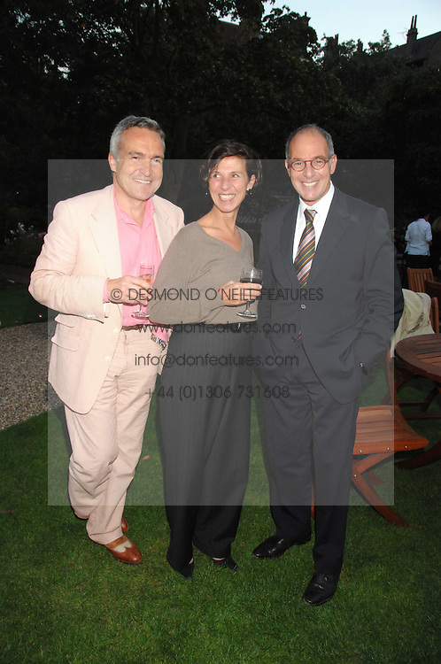Left to right, STEPHEN &amp; FLO BAYLEY and LOYD GROSSMAN at a party to celebrate the 100th issue of Waitrose's Food Illustrated magazine held at The Physic Garden, Chelsea, London on 13th September 2007.<br />