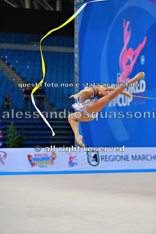 """Kudryavtseva Yana of Russia  during qualifying at ribbon in Pesaro World Cup at Adriatic Arena on  April 12, 2015, Italy. Yana """"The Queen"""" is a Russian gymnast born in Moscow on September30, 1997. Until her retirement in 2017 was one of atllete most awarded in the history of rhythmic gymnastics."""