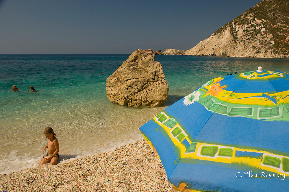 A child playing on Petani Beach on the Lixourian Peninsula, Kefalonia, The Ionian Islands, Greece