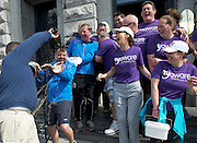 """The cast and crew who after walking 108 miles from Donegal to Galway for Ronnie Whelan's """"Myaware.ie Annual Walk"""" in aid of Myasthenia, arrived to Hotel Meyrick in Galway city centre where Love/Hate's Elmo Laurence Kinlan got drenched by Paul Brennan with a bottle of bubbly. Photo:Andrew Downes"""