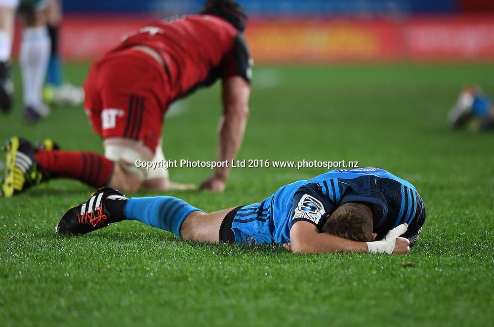 An injured Piers Francis lies on the ground during the Blues v Crusaders Super Rugby match at Eden Park, Auckland, New Zealand. Saturday 28 May 2016. © Copyright Photo: Andrew Cornaga / www.Photosport.nz
