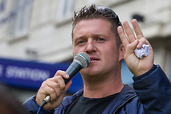 © Licensed to London News Pictures . 07/09/2013 . London , UK . Stephen Yaxley-Lennon (aka Tommy Robinson ) the EDL leader , speaks outside Aldgate Station in East London . The EDL hold a march and demonstration in London today (Saturday 7th September 2013) . Photo credit : Joel Goodman/LNP