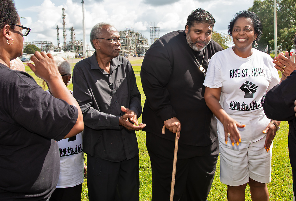 Sharon Lavigne, founder of Rise St. James, Robert Taylor, and Rev. .Barbar in front of the Denka/DuPont plant .