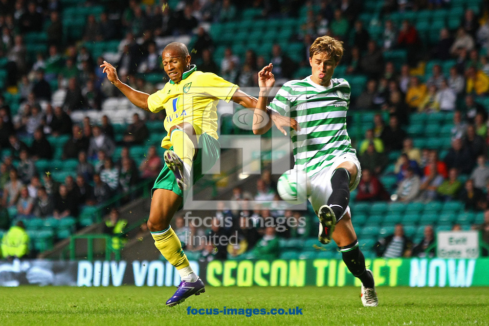 Picture by Paul Chesterton/Focus Images Ltd +44 7904 640267.24/07/2012.Simeon Jackson of Norwich and Mikael Lustig of Celtic in action during the Friendly match at Celtic Park, Glasgow.