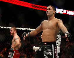 November 17, 2007; Newark, NJ, USA;  Frankie Edgar (black trunks) celebrates after defeating Spencer Fisher (red trunks) during their bout at UFC 78: Validation at the Prudential Center in Newark, NJ.  Edgar won via unanimous 3 round decision.