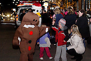 Cars continue to flood into The Greene, even as the parade is underway during the Santa parade and tree lighting celebration at The Greene towne square in Beavercreek, Saturday, November 19, 2011.
