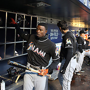 NEW YORK, NEW YORK - APRIL 12: Dee Gordon, (left), Miami Marlins, with team mate Christian Yelich in the dugout preparing to bat during the Miami Marlins Vs New York Mets MLB regular season ball game at Citi Field on April 12, 2016 in New York City. (Photo by Tim Clayton/Corbis via Getty Images)