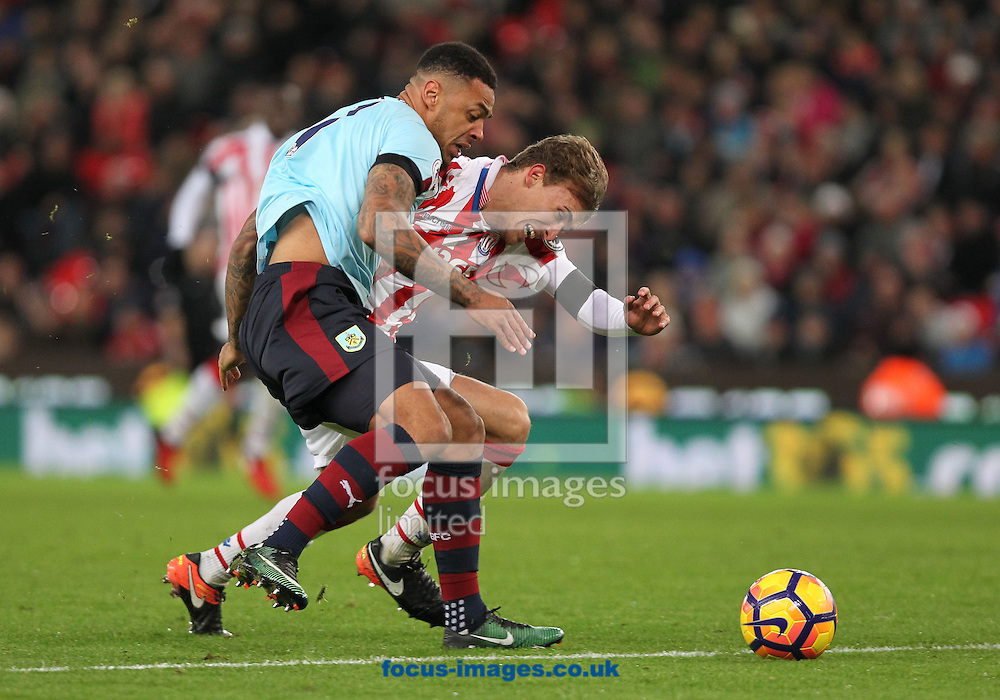 Marc Muniesa of Stoke City and Andre Gray of Burnley in action during the Premier League match at the Bet 365 Stadium, Stoke-on-Trent.<br /> Picture by Michael Sedgwick/Focus Images Ltd +44 7900 363072<br /> 03/12/2016