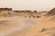 A barren wadi in the Sahara Suda (Black Desert), Egypt