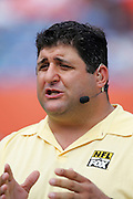 MIAMI - NOVEMBER 6:  FOX television sideline reporter Tony Siragusa gives an update on the field during the Miami Dolphins game against the Atlanta Falcons on November 6, 2005 at Dolphins Stadium in Miami, Florida. The Falcons defeated the Dolphins 17-10. ©Paul Anthony Spinelli *** Local Caption *** Tony Siragusa