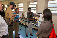 """8669, 8673, 8675 - Project Manager with the Chicago Department of Transportation (CDOT), Tanera Adams talks with residents about the current status of the Darrow Bridge restoration project Tuesday evening, August 22nd, 2017 at the Jackson Park Fieldhouse located at 6400 S. Stony Island.<br /> <br /> Please 'Like' """"Spencer Bibbs Photography"""" on Facebook.<br /> <br /> Please leave a review for Spencer Bibbs Photography on Yelp.<br /> <br /> All rights to this photo are owned by Spencer Bibbs of Spencer Bibbs Photography and may only be used in any way shape or form, whole or in part with written permission by the owner of the photo, Spencer Bibbs.<br /> <br /> For all of your photography needs, please contact Spencer Bibbs at 773-895-4744. I can also be reached in the following ways:<br /> <br /> Website – www.spbdigitalconcepts.photoshelter.com<br /> <br /> Text - Text """"Spencer Bibbs"""" to 72727<br /> <br /> Email – spencerbibbsphotography@yahoo.com"""