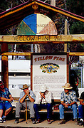 THIS PHOTO IS AVAILABLE FOR WEB DOWNLOAD ONLY. PLEASE CONTACT US FOR A LARGER PHOTO. Idaho. Yellow Pine. Two men playing harmonica together as onlookers enjoy the music.