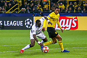 Borussia Dortmund defender Abdou Diallo (4) bring down Tottenham Hotspur midfielder Moussa Sissoko (17) no penalty during the Champions League round of 16, leg 2 of 2 match between Borussia Dortmund and Tottenham Hotspur at Signal Iduna Park, Dortmund, Germany on 5 March 2019.