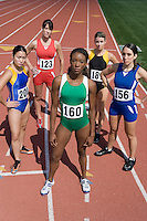 Female athletes ready to run, high angle view