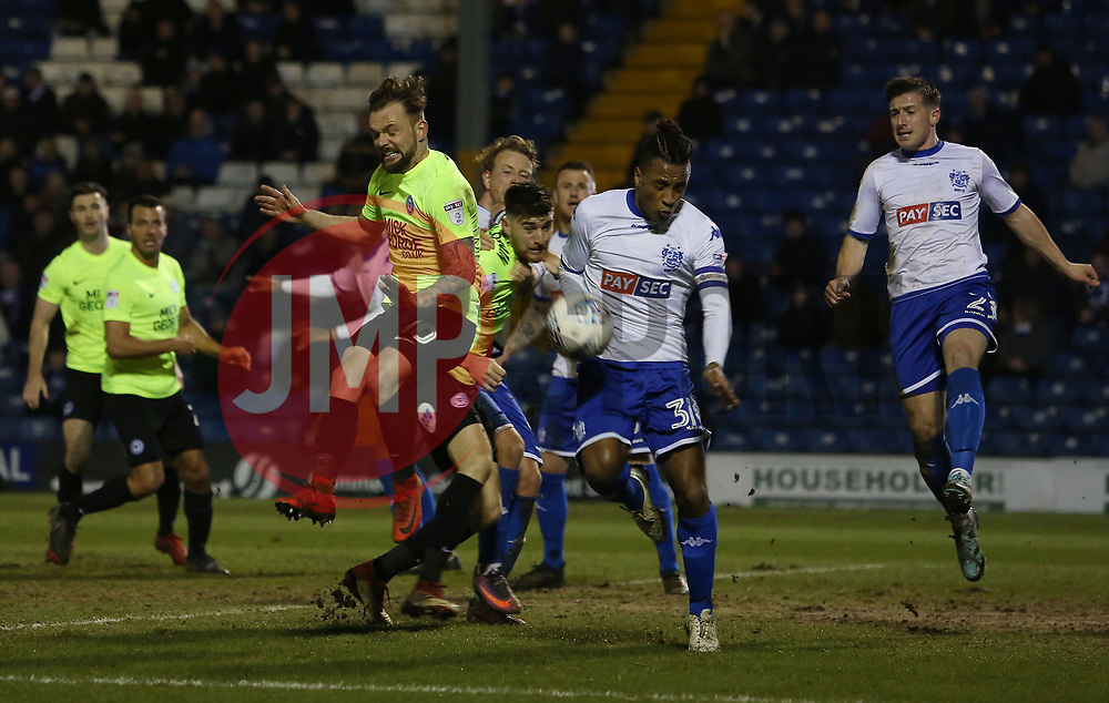 Danny Lloyd of Peterborough United challenges for the ball with Neil Danns of Bury - Mandatory by-line: Joe Dent/JMP - 13/03/2018 - FOOTBALL - Gigg Lane - Bury, England - Bury v Peterborough United - Sky Bet League One