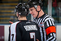 KELOWNA, CANADA - FEBRUARY 10: Referee Ward Pateman speaks to Ty Ronning #7 of the Vancouver Giants on the ice against the Kelowna Rockets on February 10, 2017 at Prospera Place in Kelowna, British Columbia, Canada.  (Photo by Marissa Baecker/Shoot the Breeze)  *** Local Caption ***