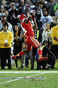 Kansas City Chiefs wide receiver Demarcus Robinson (14) leaps and catches a second quarter pass for a gain of 33 yards to the Chiefs 34 yard line during the 2017 NFL week 7 regular season football game against the against the Oakland Raiders, Thursday, Oct. 19, 2017 in Oakland, Calif. The Raiders won the game 31-30. (©Paul Anthony Spinelli)