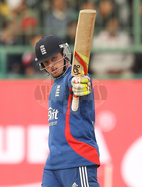 Ian Bell of England celebrates his fifty during the 5th Airtel ODI between India and England held at the HPCA Stadium in Dharamsala, Himachal Pradesh, India on the 27th January 2013..Photo by Ron Gaunt/BCCI/SPORTZPICS ..Use of this image is subject to the terms and conditions as outlined by the BCCI. These terms can be found by following this link:..http://www.sportzpics.co.za/image/I0000SoRagM2cIEc