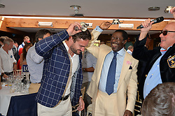Left to right, THOM EVANS and PRINCE ALBERT ESIRI of Nigeria at The Royal Salute Coronation Cup Polo held at Guards Polo Club,  Smiths Lawn, Windsor Great Park, Egham on 23rd July 2016.