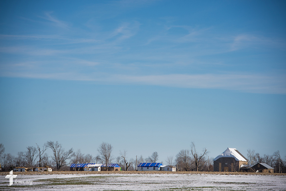 A skyline composed of damaged homes and Saint John Lutheran Church is seen entering into New Minden, Ill., on Wednesday, Dec. 18, 2013. The tornado that damaged the church and surrounding homes in November was one among nearly two dozen that swept through the state, killing a total of seven. LCMS Communications/Erik M. Lunsford