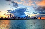 As the sun sets on a beautiful spring evening, storm clouds begin to form over the famous Chicago skyline.