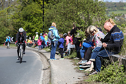 © Licensed to London News Pictures. 30/04/2016. Harewood, UK. Spectators wait for the riders to ascend the climb in Harewood near Leeds in West Yorkshire during the second stage of the 2016 Tour De Yorkshire. The three-day road cycling race held annually across Yorkshire is in it's second year. Photo credit : Ian Hinchliffe/LNP