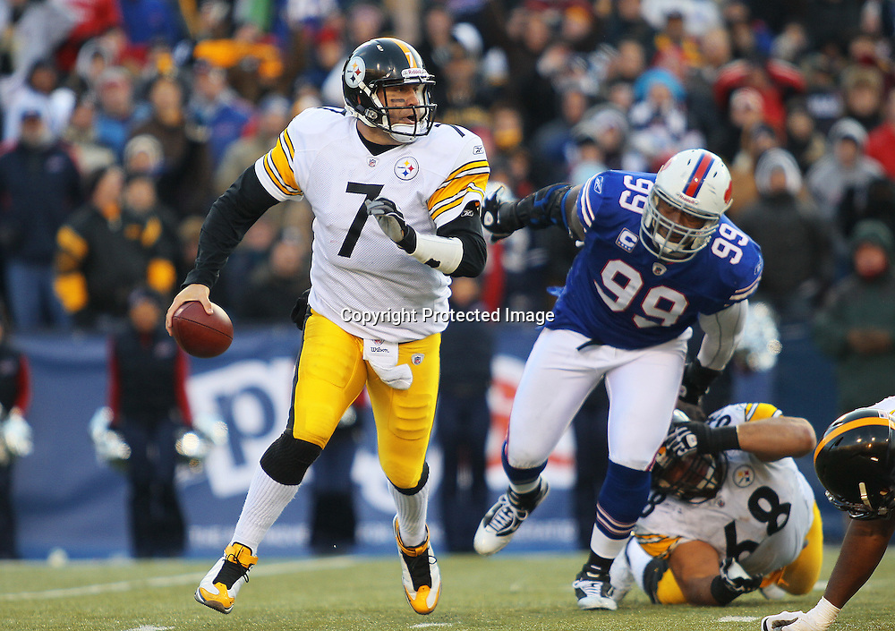 28 November 2010: Pittsburgh Steelers quarterback Ben Roethlisberger (7) escapes from Buffalo Bills defensive tackle Marcus Stroud (99) during a game against the Buffalo Bills at Ralph Wilson Stadium in Orchard Park, NY.