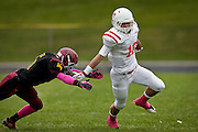 Preston Curtis, right, breaks past a Mountain View tackler during the East High School vs. Mountain View High School football game at Mountain View High School in Orem, Tuesday, Oct. 23, 2012. The Panthers won 49-0.