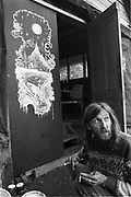 Hank smoking and painting at the back of Goose hall, Glastonbury, 1989.