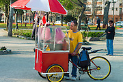 Cotton candy man caking and selling coton candy in the park, Santiago, Chile
