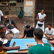 CUBA (La Habana). 2009. Playing 'domino' in the streets of Central Habana. Due to low salaries some young people prefer to stay in the streets rather than getting a job.
