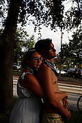 Rich Cuzzi, 24, left, and his friend Aislinn Bauer, 20, both of New York City, hug during a rally in Ybor City as others stop briefly to watch during the 2012 Republican National Convention on August 28, 2012 in Tampa, Fla.