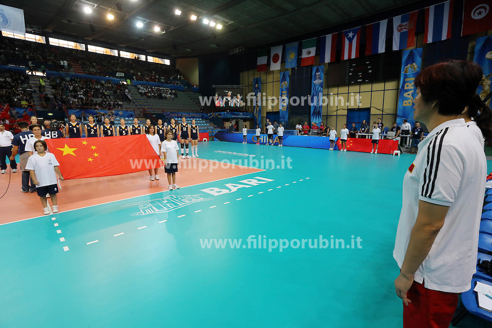 China coach Lang Ping listens to China national anthem