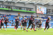 Manchester United Midfielder Paul Pogba leads the players in warm up training during the Premier League match between Brighton and Hove Albion and Manchester United at the American Express Community Stadium, Brighton and Hove, England on 19 August 2018.
