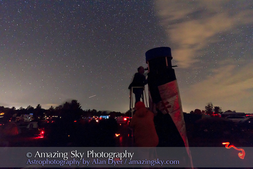 Observer using a large Dobsonian reflector telescope at the annual Starfest star party near Mt Forest, Ontario, August 2011. A single exposure of 30s at ISO 3200 with Canon 7D and 10-22mm lens.
