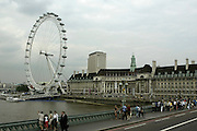 The London Eye is a giant Ferris wheel on the South Bank of the River Thames in London, England on July 9, 2003. ©Paul Anthony Spinelli